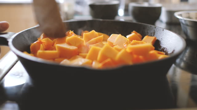 cooking diced butternut squash - vegetable stock videos & royalty-free footage