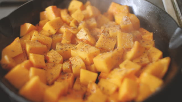 cooking diced butternut squash - food stock videos & royalty-free footage