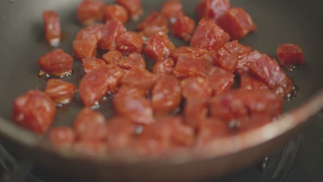 cooking diced chorizo sausage in a pan - chorizo stock videos & royalty-free footage