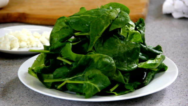 hd: cooking food in stylish kitchen - spinach salad stock videos & royalty-free footage