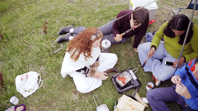 cooking food on a camping stove outdoors - east sussex stock videos & royalty-free footage