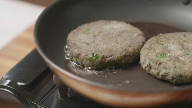 cooking green lentils vegagie burger - protein stock videos & royalty-free footage