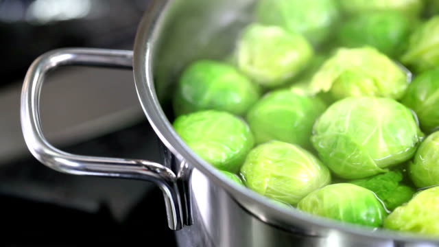 cooking greens - brussels sprout stock videos & royalty-free footage