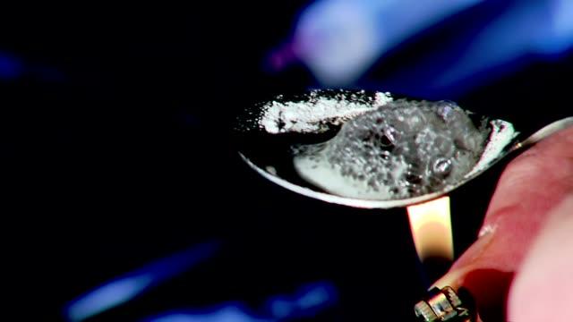 cooking heroin - heroin stock videos & royalty-free footage
