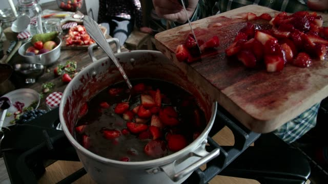 cooking homemade strawberry jam in domestic kitchen - preserve stock videos and b-roll footage