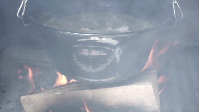 Cooking in a cauldron