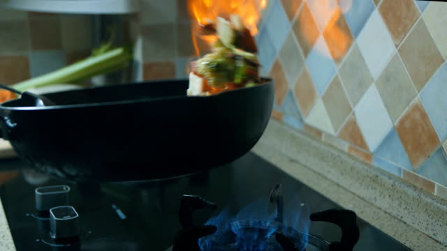 cooking in flaming pan - frying pan stock videos & royalty-free footage