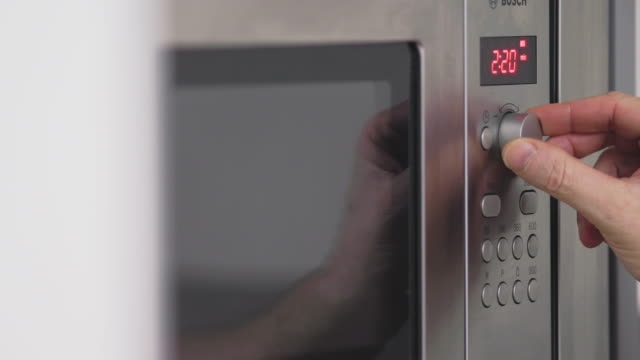 cooking in microwave - timer stock videos & royalty-free footage