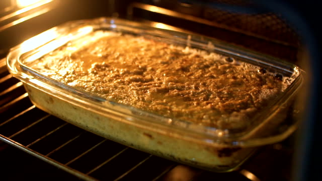 cooking in oven, slo mo - lasagna stock videos & royalty-free footage