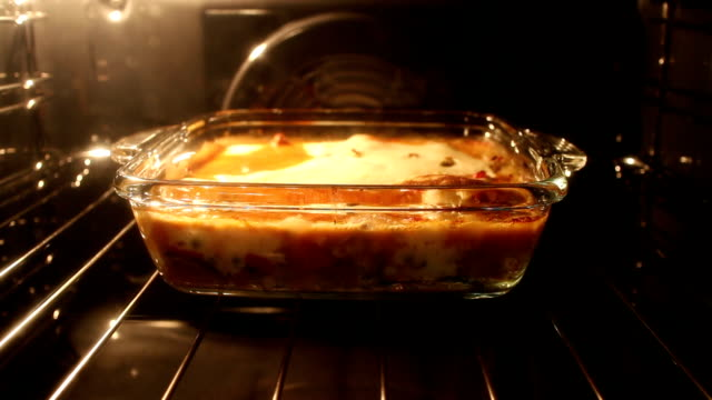 cooking in oven - oven stock videos and b-roll footage