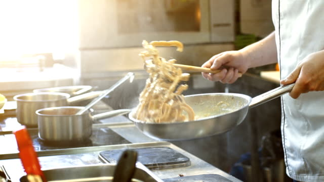 cooking in slow motion. - commercial kitchen stock videos & royalty-free footage