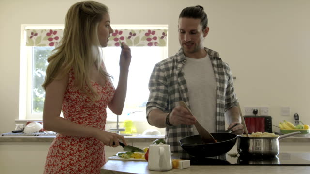 cooking in their new home - young couple stock videos & royalty-free footage