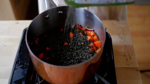 cooking lentil stew - legume family stock videos and b-roll footage
