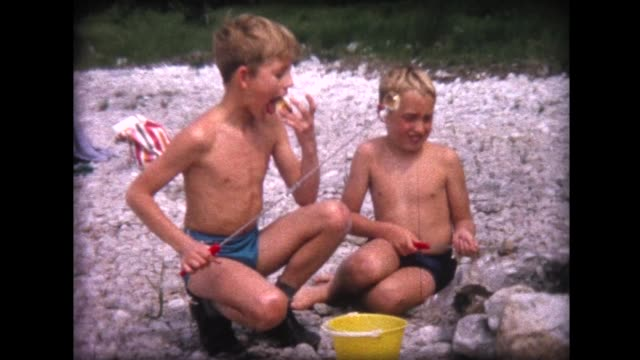 1964 cooking marshmallows on the beach - nackter oberkörper stock-videos und b-roll-filmmaterial