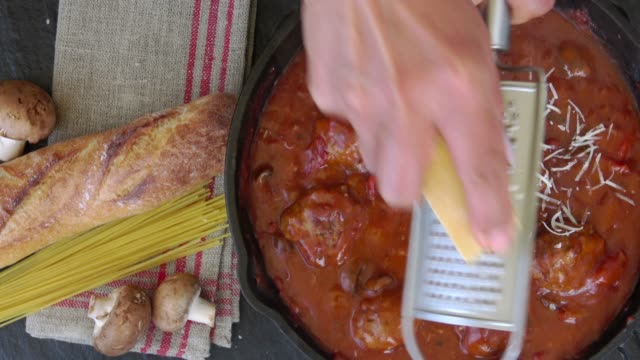 cooking meatballs in marinara sauce with parmesan cheese - spaghetti stock videos & royalty-free footage