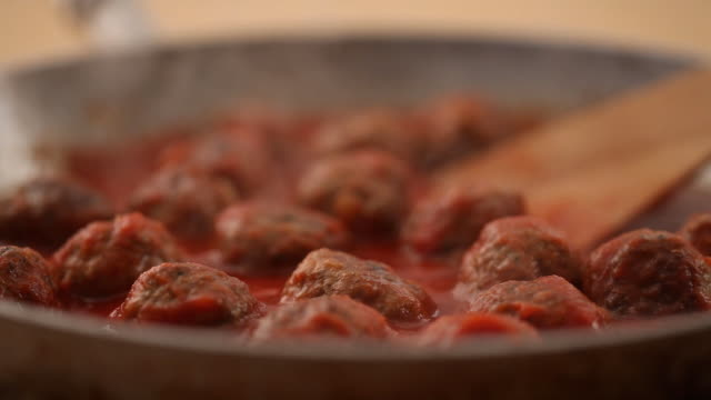 CU Cooking meatballs in pan / London, UK