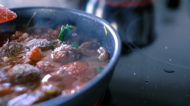 cooking meatballs in tomato sauce - montage stock videos and b-roll footage