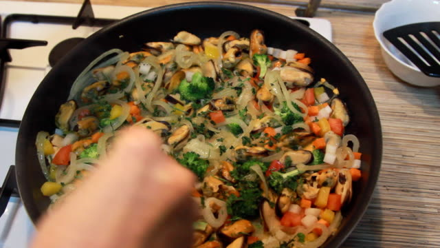 cooking mussels with multicolored vegetables - crucifers stock videos and b-roll footage