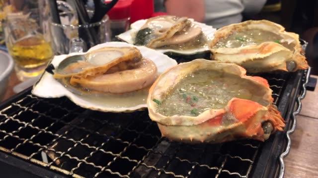 可児味噌日本料理の調理 - ムール貝点の映像素材/bロール