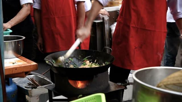 cooking of street in bangkok street food - grigliare video stock e b–roll