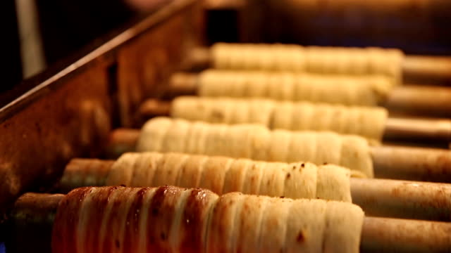 cooking of trdelnik traditional national czech sweet pastry dough. - traditionally czech stock videos & royalty-free footage