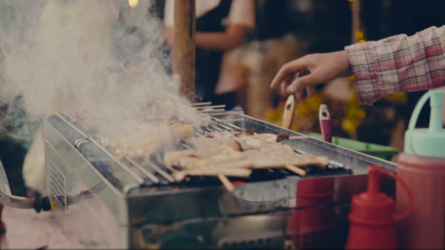 cooking on a bbq - street food stock videos & royalty-free footage