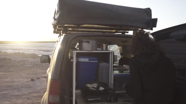 cooking on jeep at sunset - atacama region stock videos & royalty-free footage