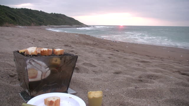 cooking on the beach - camping stove stock videos and b-roll footage
