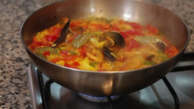 Cooking paella on a stove