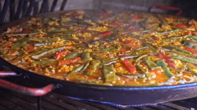 cooking paella - cucina mediterranea video stock e b–roll