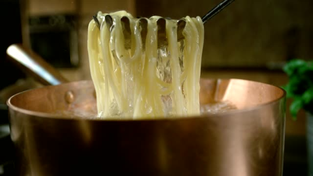 cooking pasta. table top shot - boiling stock videos & royalty-free footage
