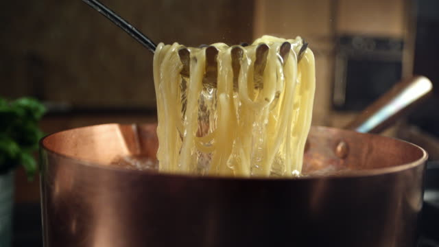 cooking pasta - spaghetti stock videos & royalty-free footage