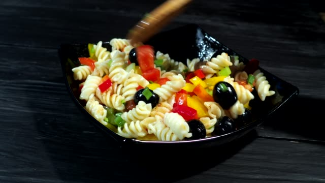 cooking pasta with fresh vegetables - salad stock videos & royalty-free footage