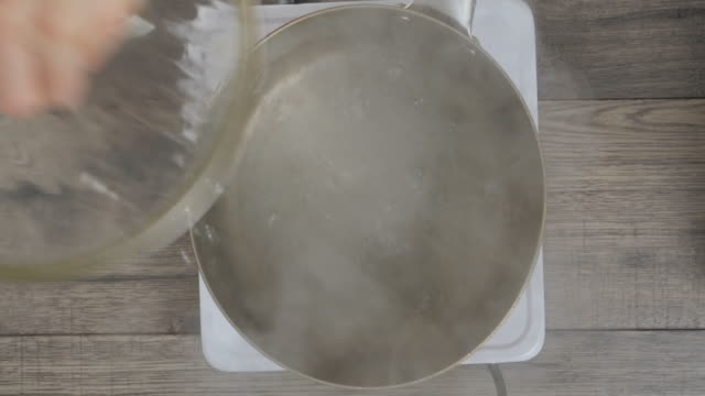 cooking penny pasta  in hot pot - boiled stock videos and b-roll footage