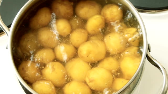 cooking potatoes, closeup - boiling stock videos & royalty-free footage