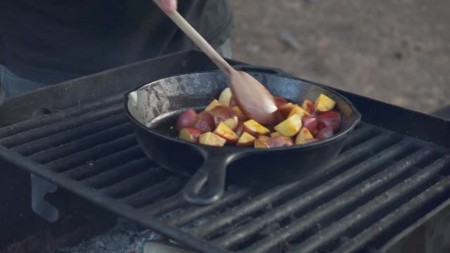 cooking potatoes over a campfire - cast iron stock videos and b-roll footage