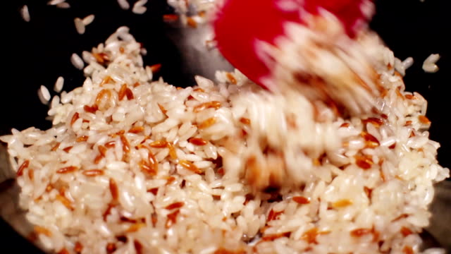 cooking rice known as pilav - 29.97fps - risotto stock videos & royalty-free footage