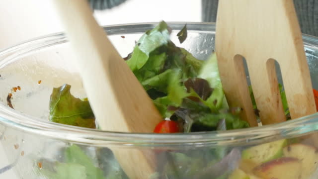 cooking salad , zoom out - vegetarian meal stock videos & royalty-free footage