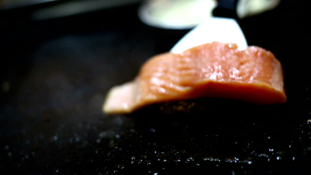 cooking salmon steak. - grilled salmon stock videos & royalty-free footage