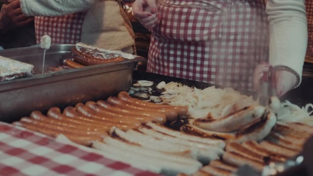 cooking sausages on the bbq - traditional festival stock videos and b-roll footage
