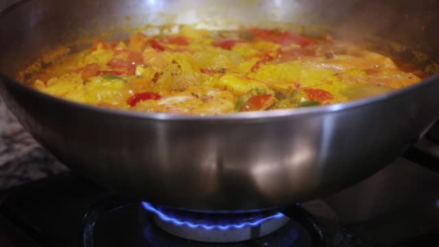 cooking seafood paella on burner - spanish culture stock videos & royalty-free footage