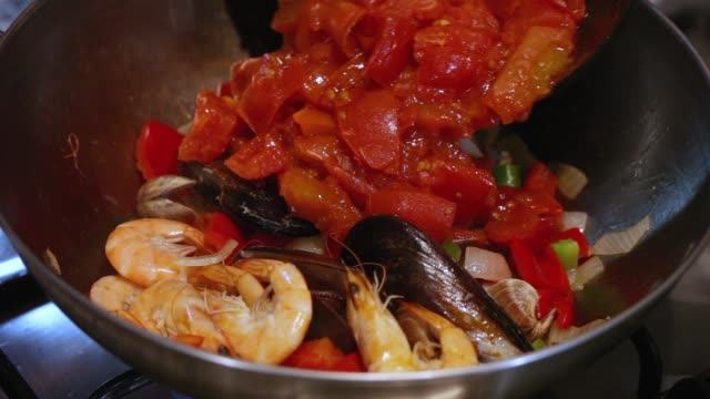 Cooking seafood paella