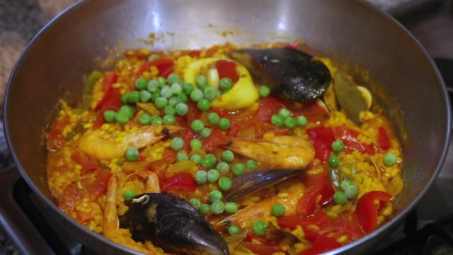 cooking seafood paella - bell pepper stock videos & royalty-free footage