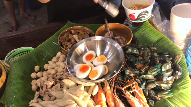 Cooking seafood Tom Yum noodles for customer , Hua Hin, Thailand.