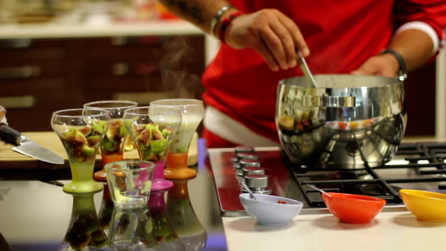 cooking some dessert - custard stock videos & royalty-free footage