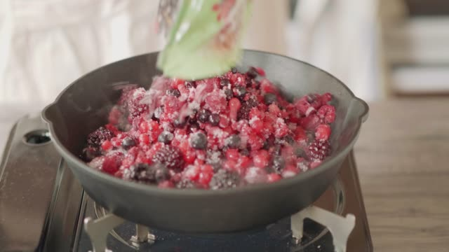cooking summer berry fruit in skillet pan - trifle dessert stock videos and b-roll footage