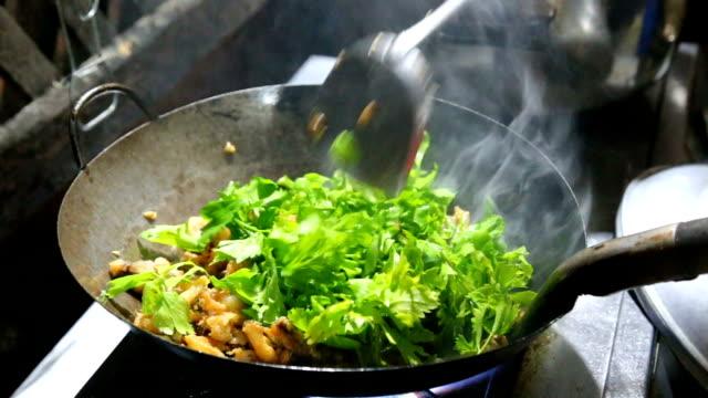 cooking thai food in pan fry. - thai food stock videos and b-roll footage