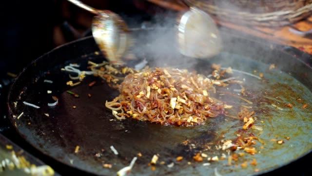 Cooking thai noodles, Noodle stir fry on pan (Pad Thai).