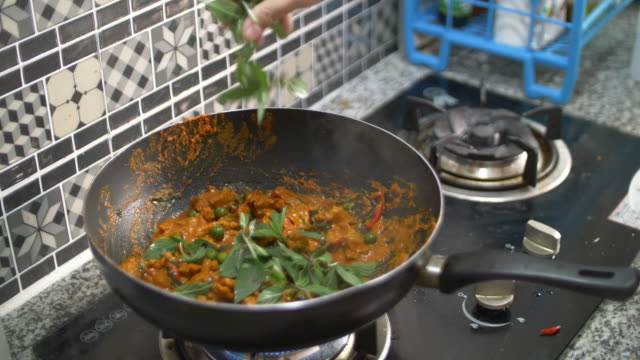 cooking thai spicy food in the kitchen - curry powder stock videos and b-roll footage