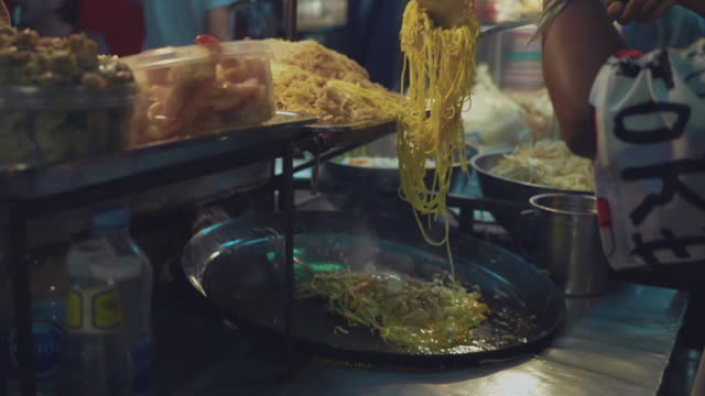 cooking the famous thai street food dish called 'pad thai', which is a stir fried dish of noodles, - thailand stock videos & royalty-free footage